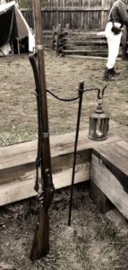Musket and Lamp Stand